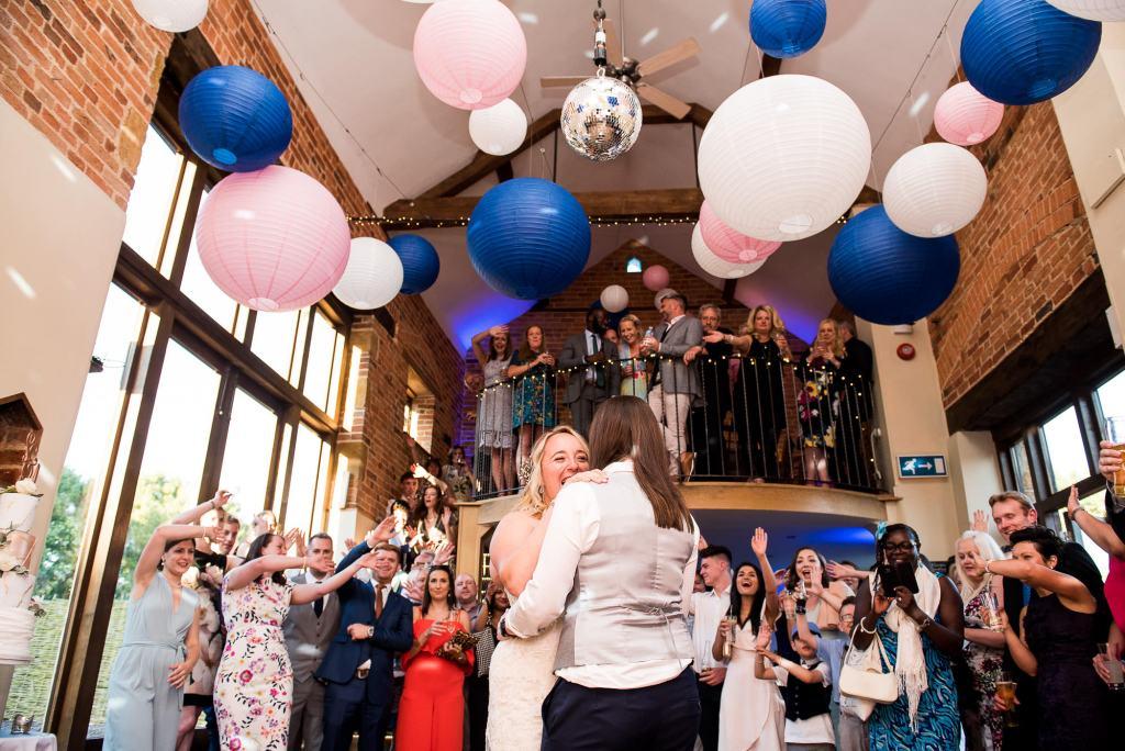lgbt wedding photographer, brides share their first dance at Dodmoor House