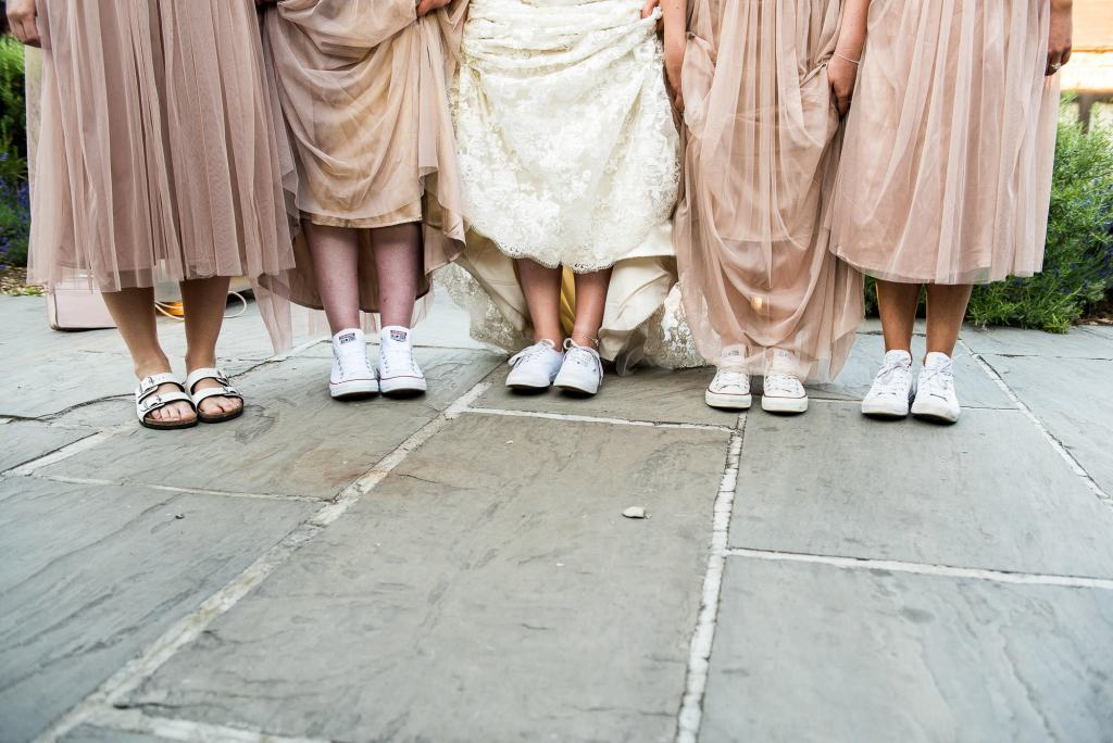 lgbt wedding photographer, bridesmaids and bride wear matching shoes for the evening reception