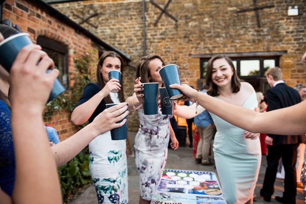 lgbt wedding photographer, bridal party play beer pong at wedding reception