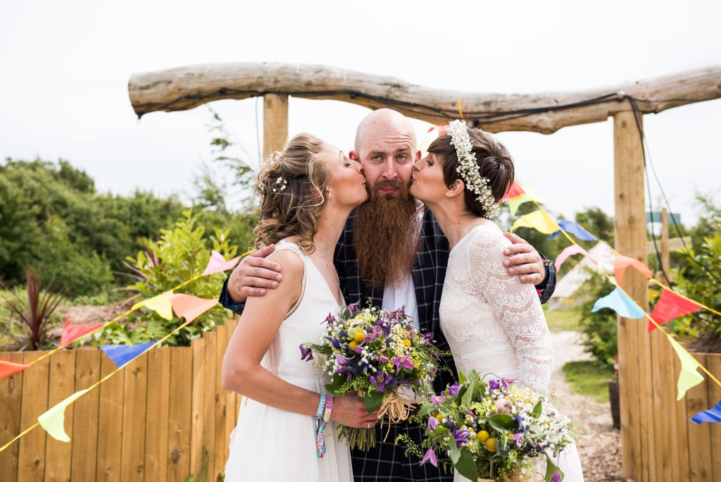 creative wedding photography surrey, brides kiss their best man on the cheeks, LGBT wedding photographer