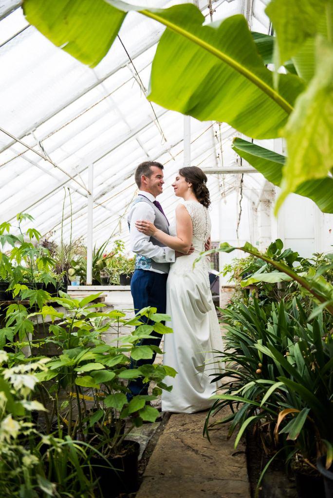Fun wedding photography, candid wedding portrait in a greenhouse