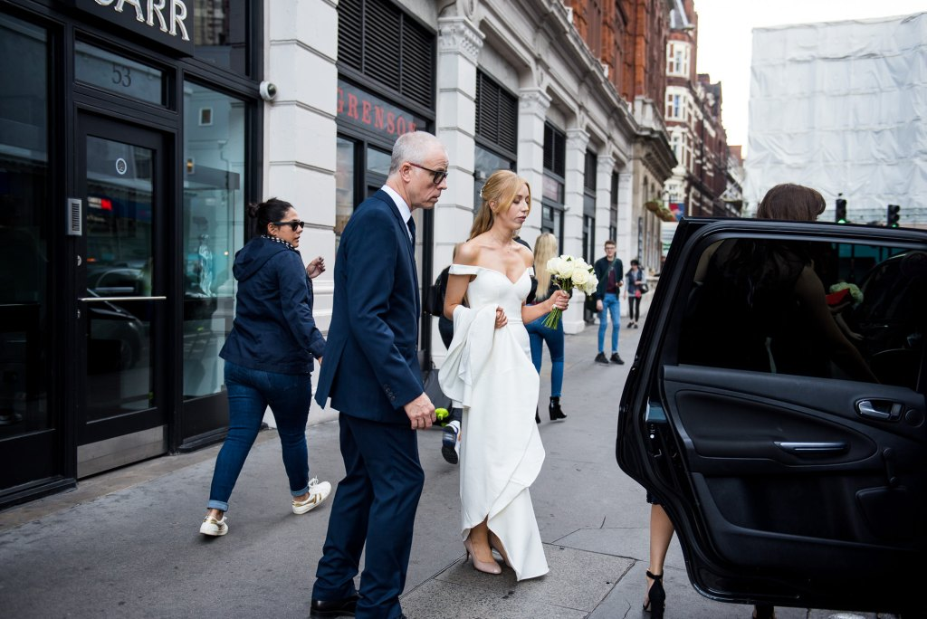 Old Marylebone Town Hall Wedding, bride makes her way to the ceremony