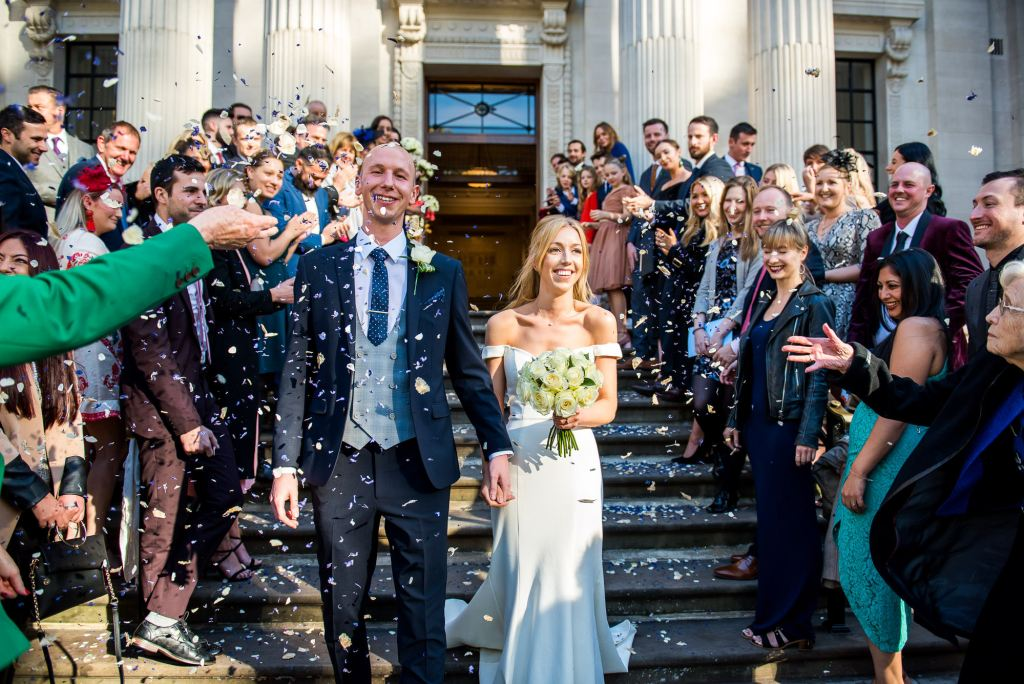 Old Marylebone Town Hall Wedding, stylish bride and groom exit their wedding to confetti line, London wedding