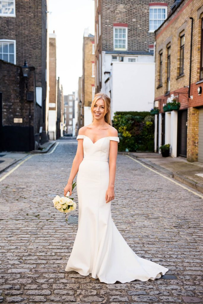 Old Marylebone Town Hall Wedding, bride in traditional off the shoulder Sherri Hill wedding dress