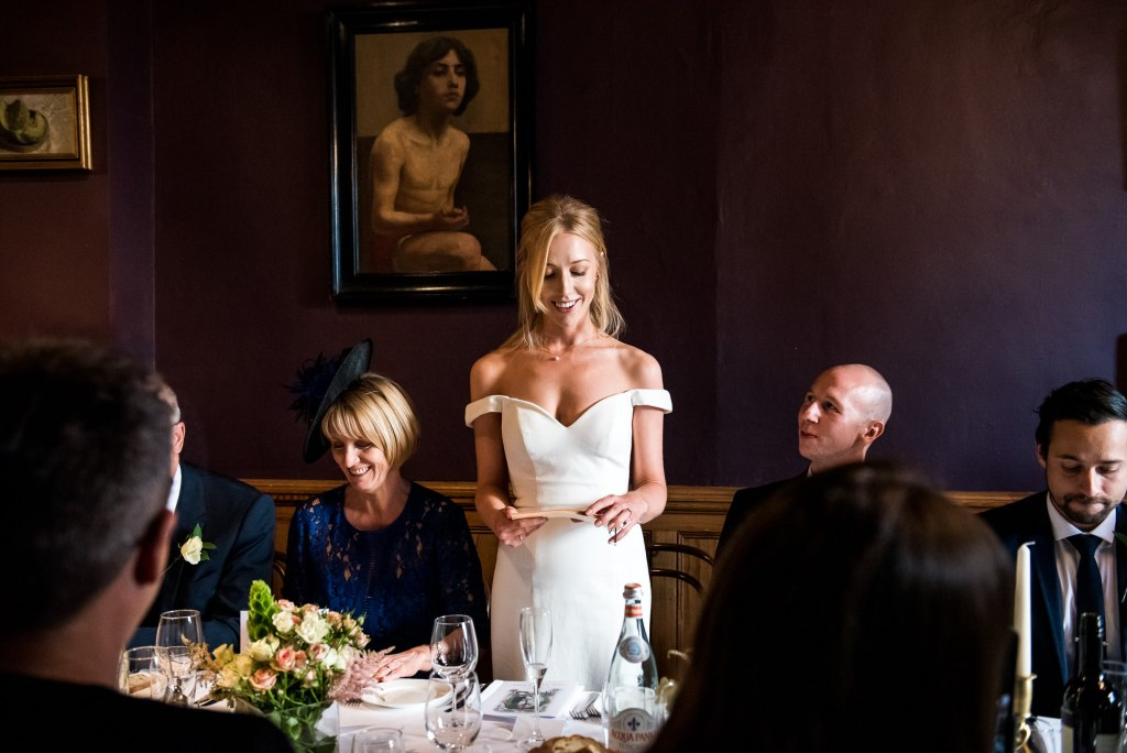 Old Marylebone Town Hall Wedding, bride in a sleek and stylish wedding dress gives emotional wedding breakfast speech