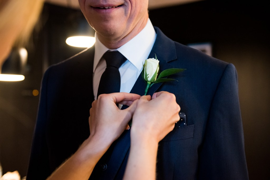 Old Marylebone Town Hall Wedding, simple and stylish single white rose button hole