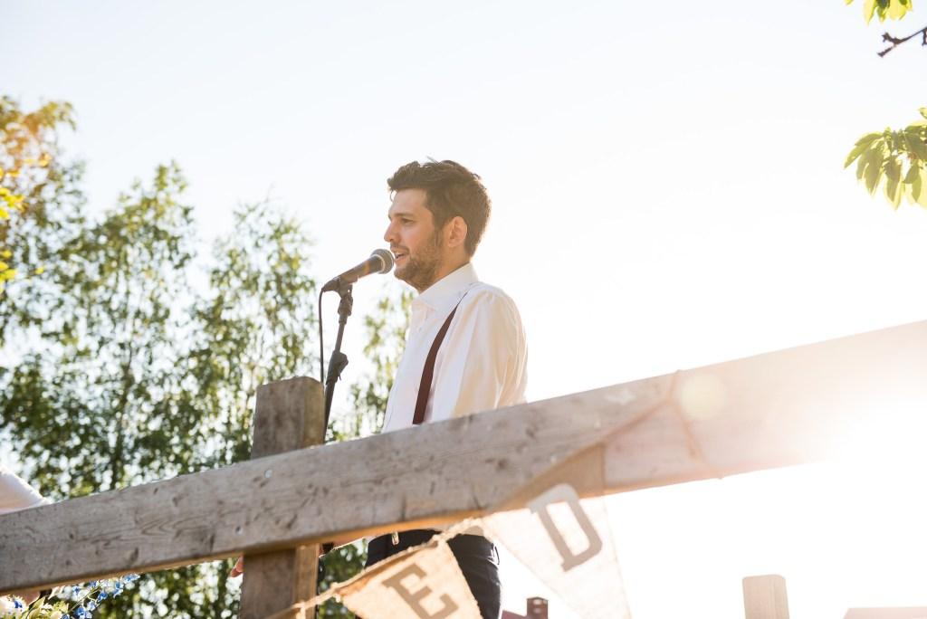 LGBT wedding photography, best man gives a speech in the evening sun, destination wedding photography Sweden