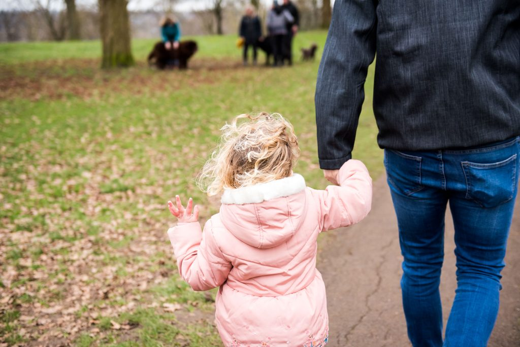 family photography guildford, little girl holds hands with her father