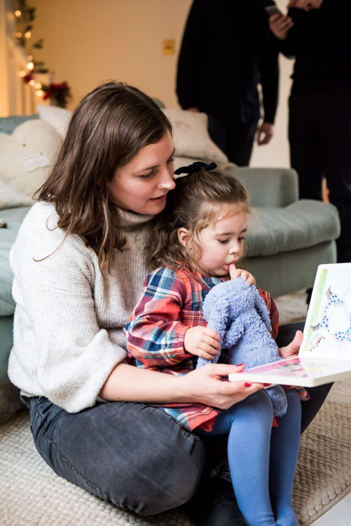 Mother and daughter read together on a Christmas Family Photography Shoot