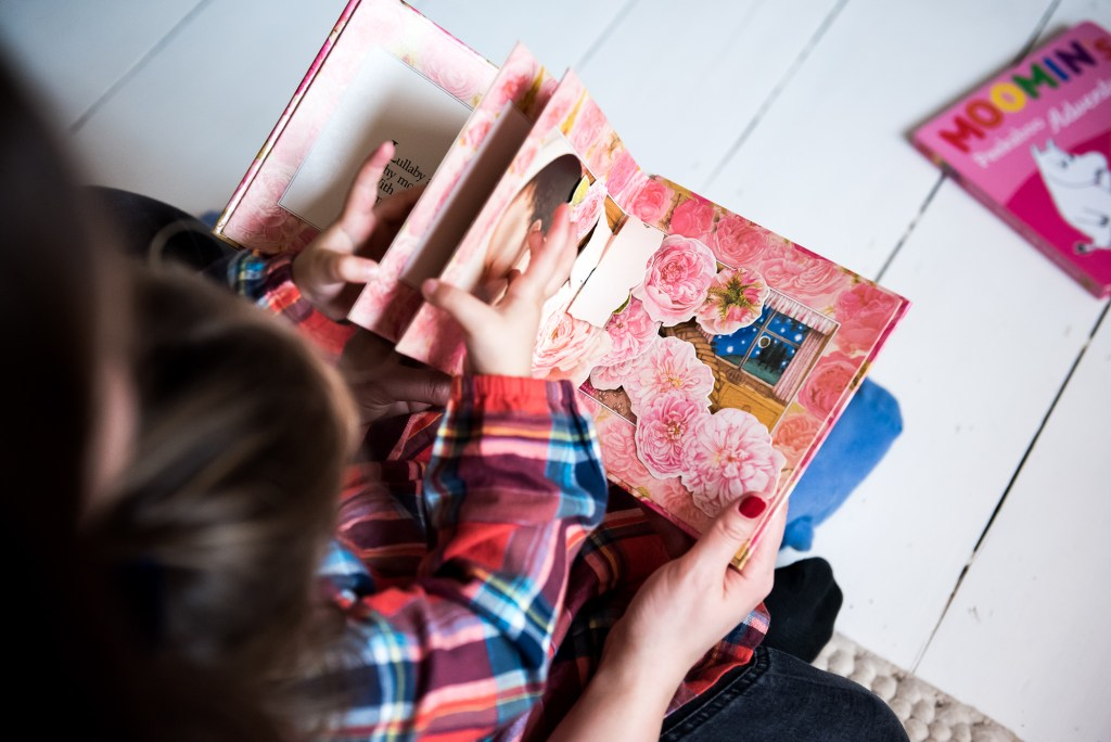 London Family Photography, child and mother read a story book together