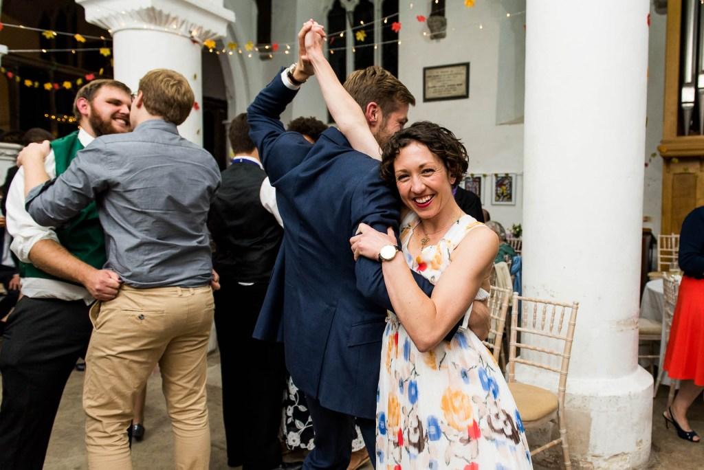 Documentary wedding photographer surrey, Couple dance together at Surrey wedding