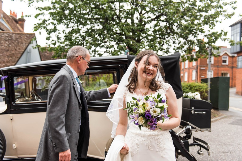 Bride arrives for Surrey wedding with her parents