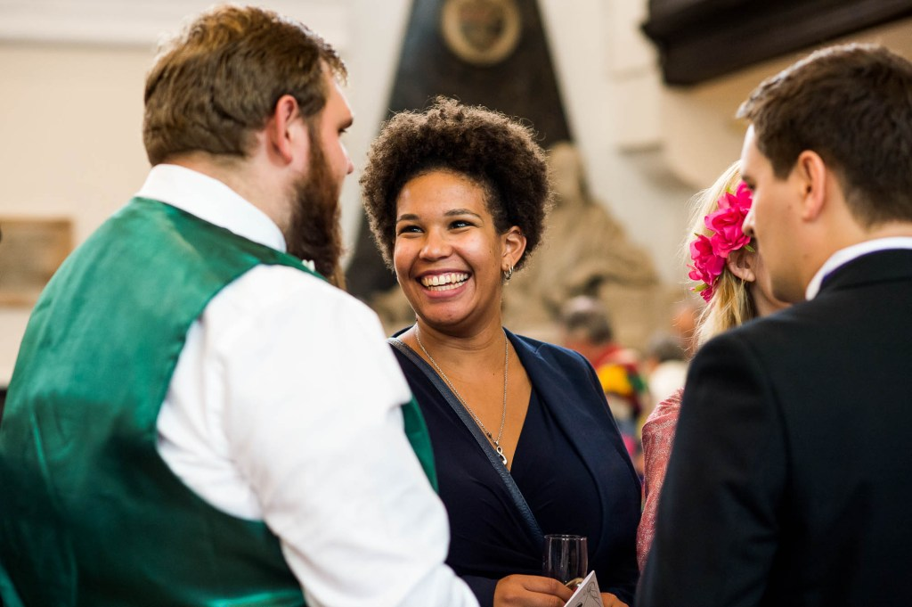 Beautiful woman smiles candidly during drinks reception