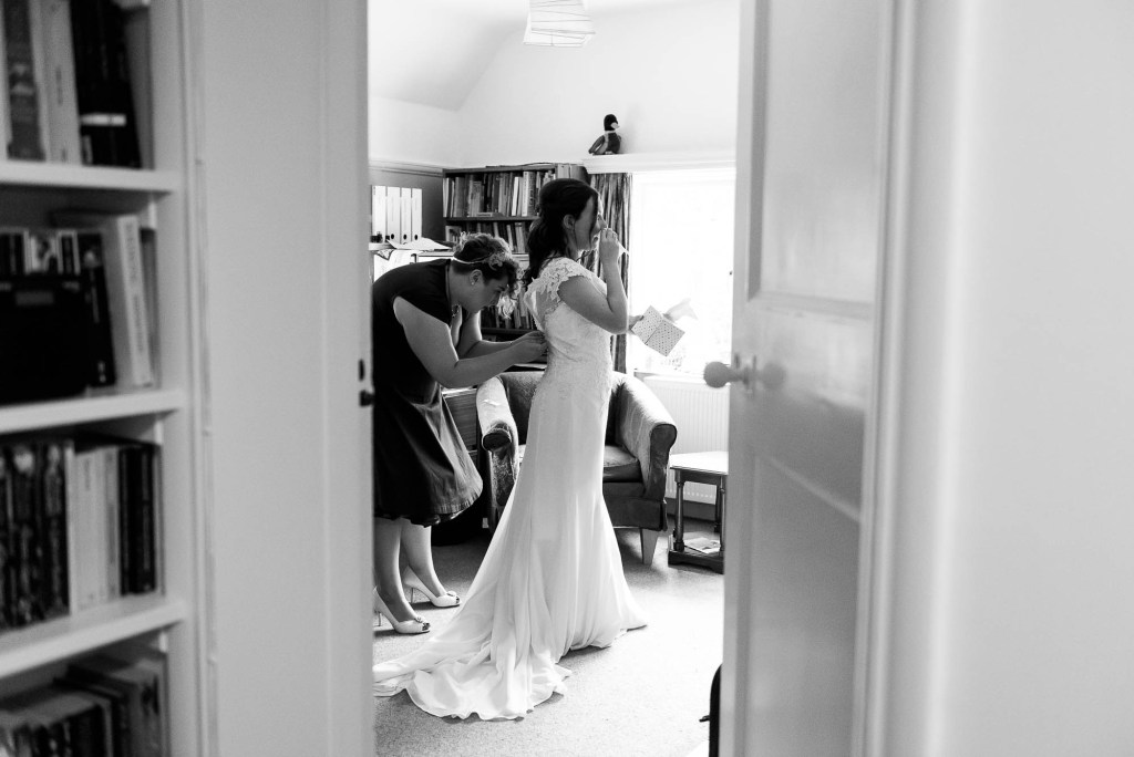 Black and white image in a documentary photography style for Surrey wedding