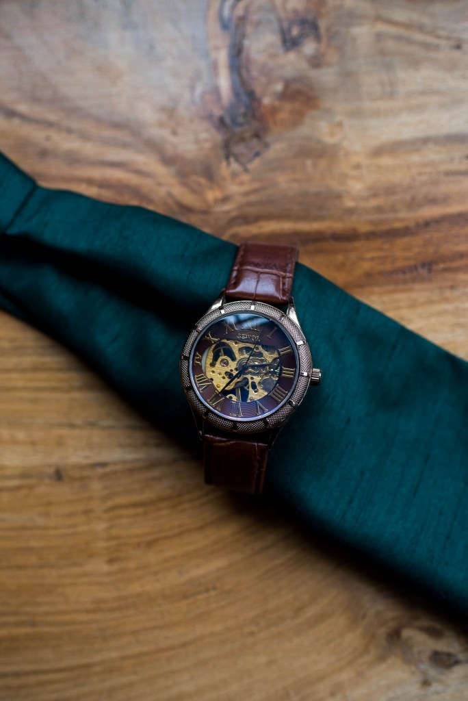 Wedding details - A Rustic watch is wrapped around a wedding pocket square