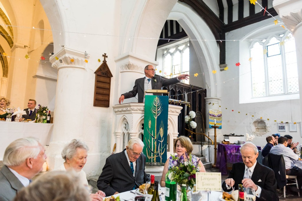 Vicar gives a speech to say grace before the wedding breakfast