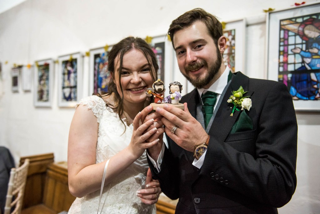 Lord of the Rings themed wedding cake toppers
