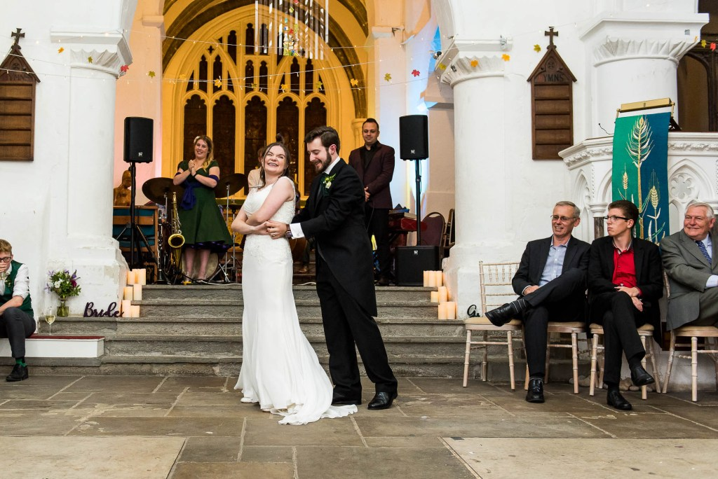 Bride and groom start their choreographed first dance