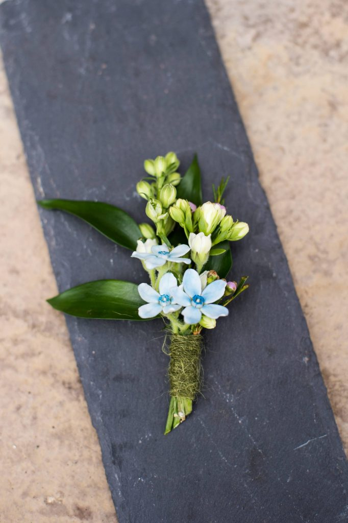 Soft baby blue button hole for Surrey wedding styled shoot