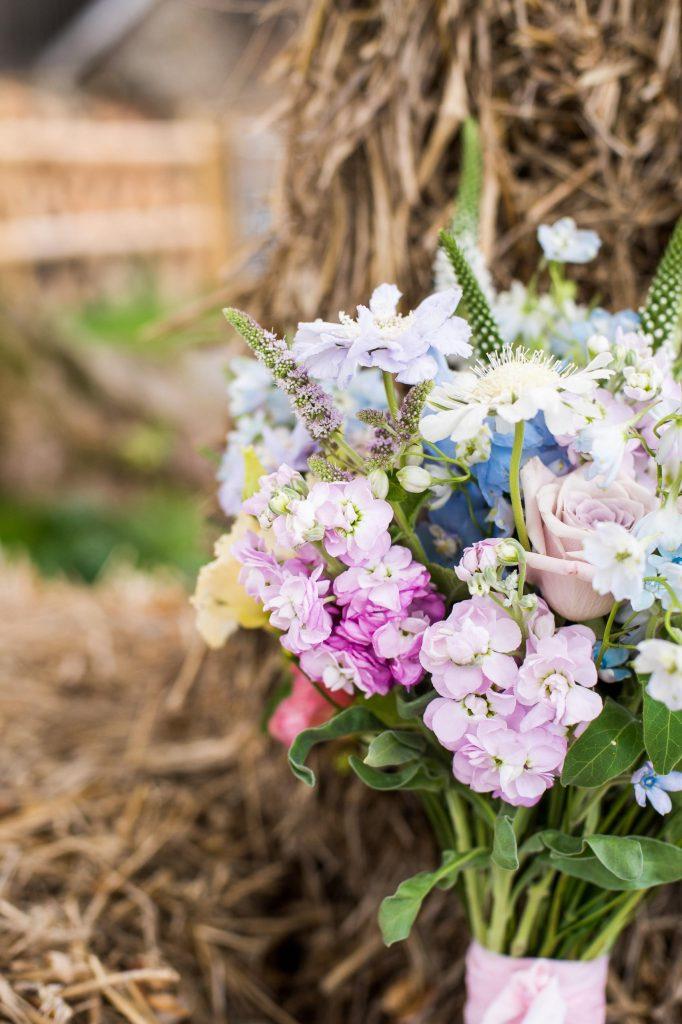 Soft pastel coloured floral arrangement for Surrey wedding styled shoot