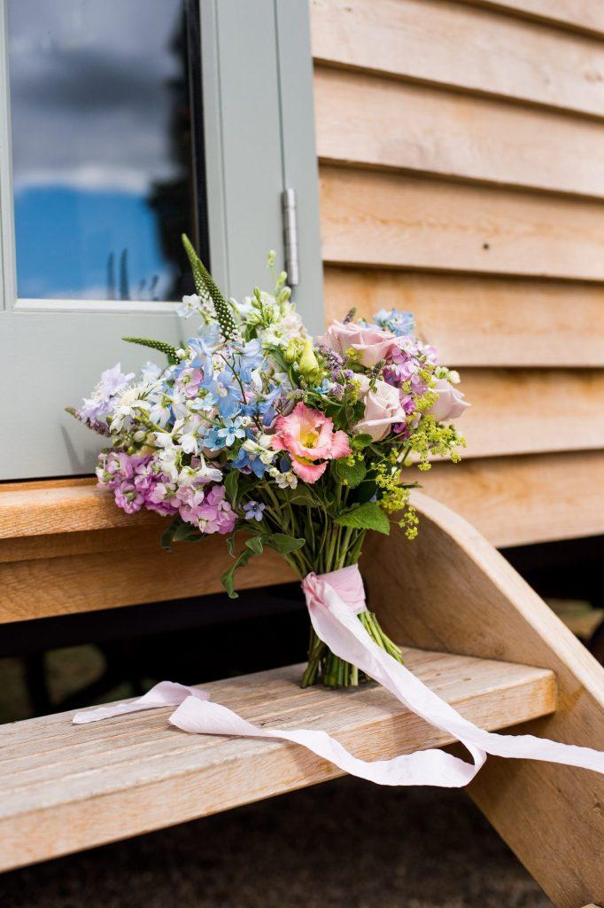 Pastel floral arrangement with pink silk ribbon