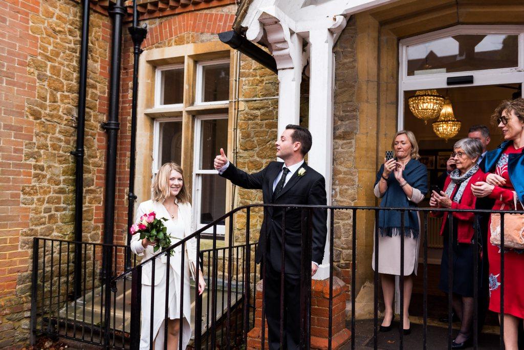 Groom gives thumbs up at intimate surrey wedding
