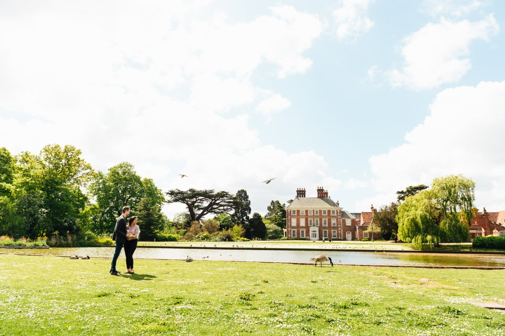 Engaged couple standing in the grounds of Forty Hall