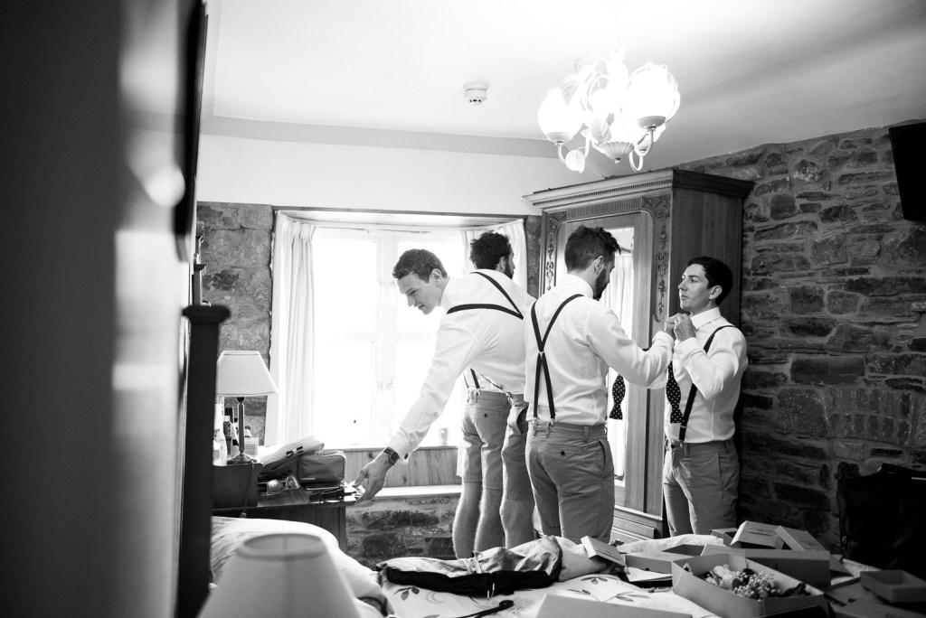 groomsmen sort out each others ties