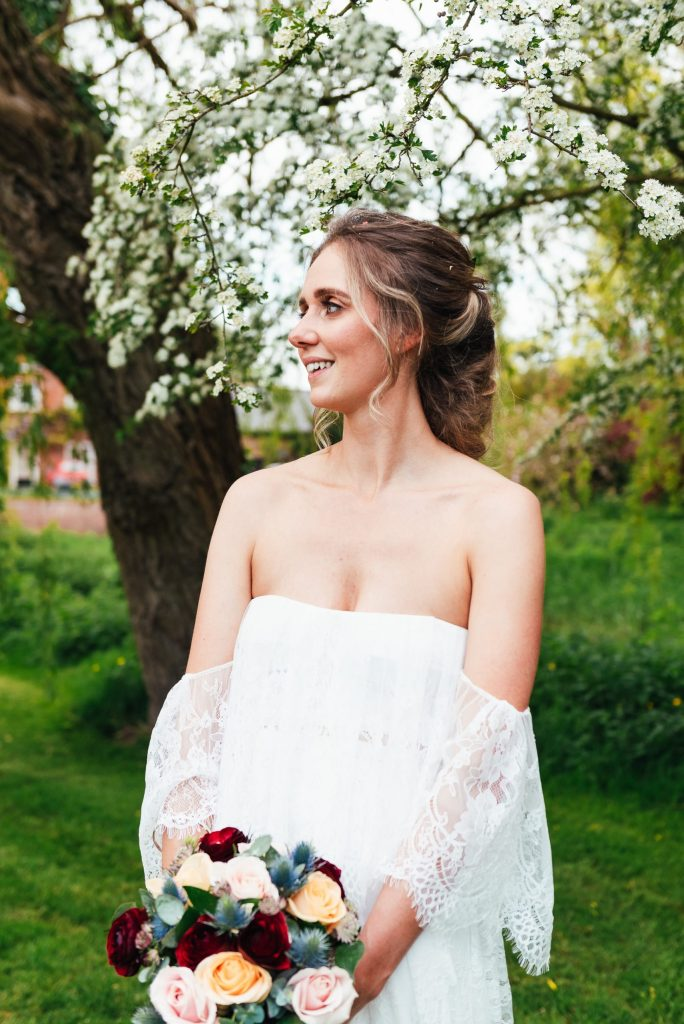 Beautiful bride in a strapless Grace Loves Lace wedding dress
