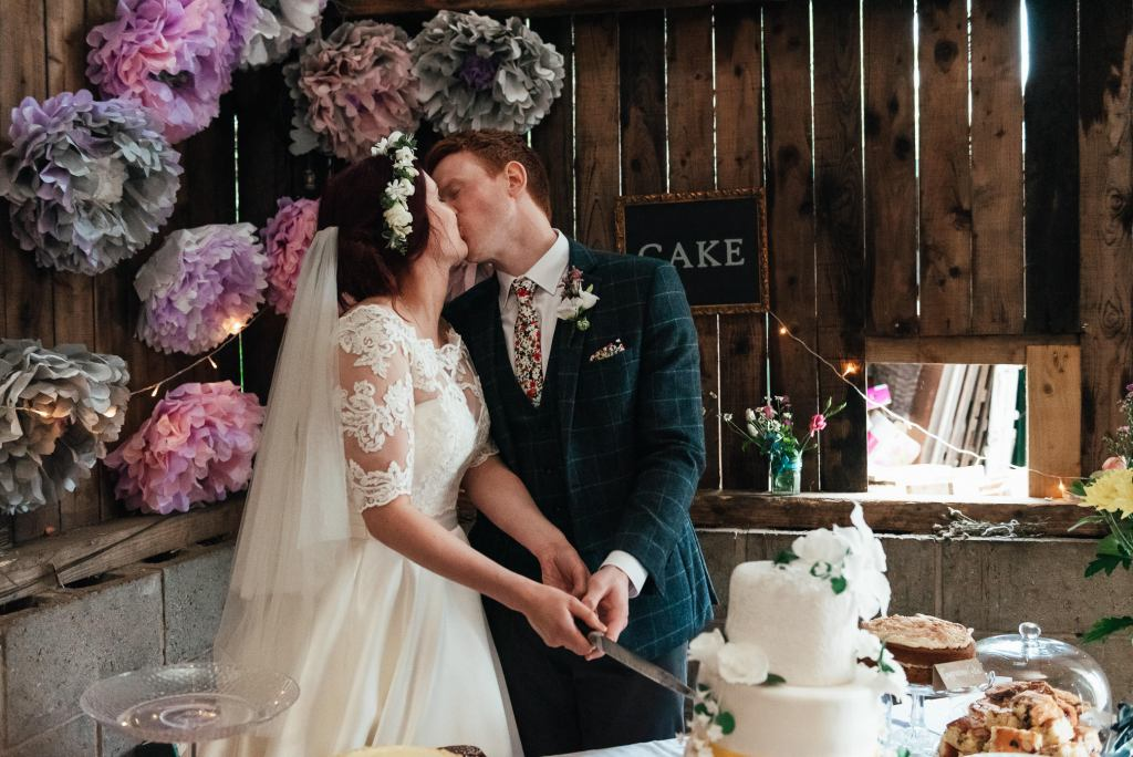 Fun cake cutting photograph for Yorkshire wedding photography
