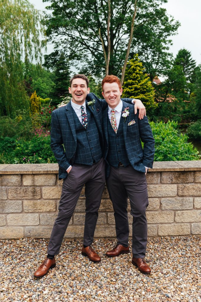 Groom and his best man laugh together, Yorkshire wedding Photography