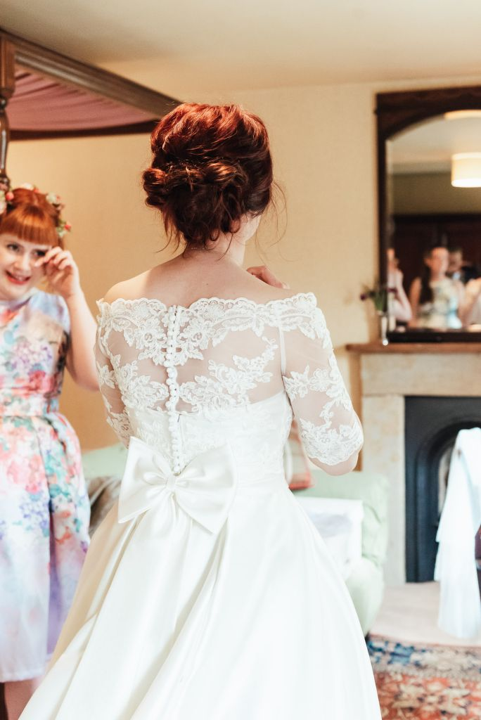 Lace over top with a satin bow for gorgeous strapless wedding dress