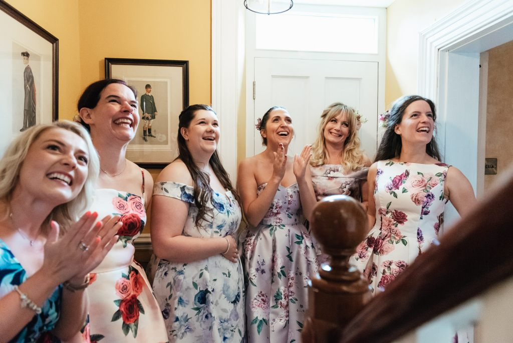 Bridesmaid's reactions from seeing the bride in her dress