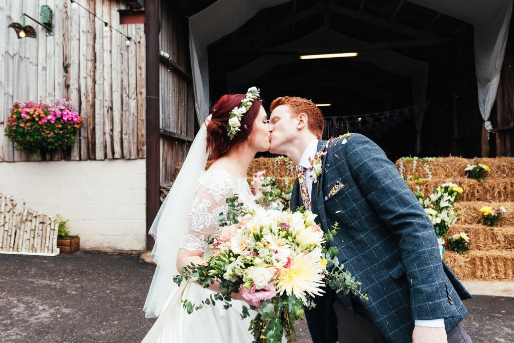 Couple kiss after ceremony, Deepdale Farm wedding