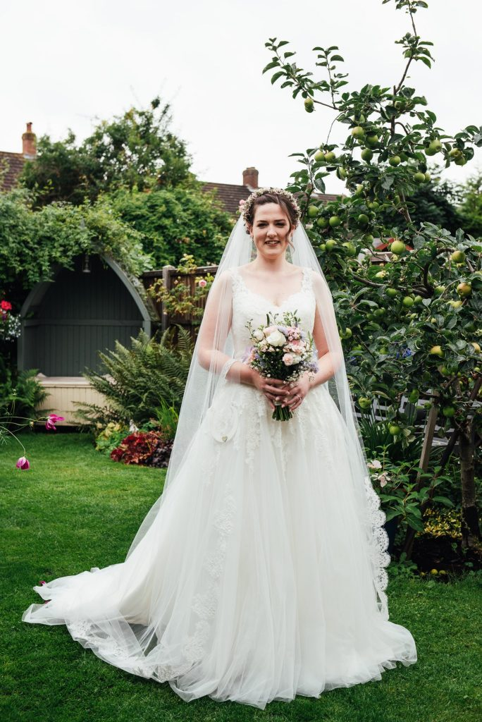 Beautiful bridal portrait in summer English garden