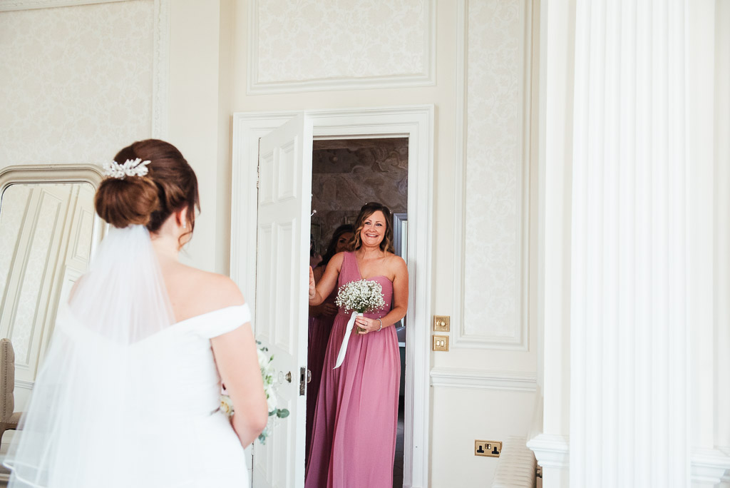 First look of the beautiful bride from her bridesmaids