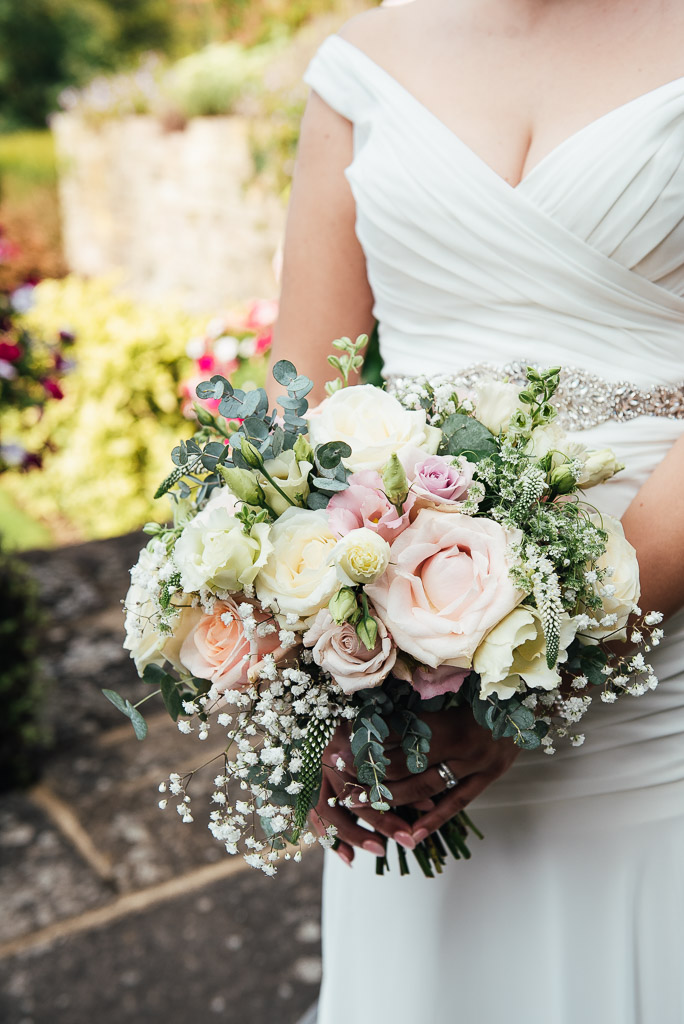 Beautiful bridal bouquet of gypsophila, pink roses and eucalyptus