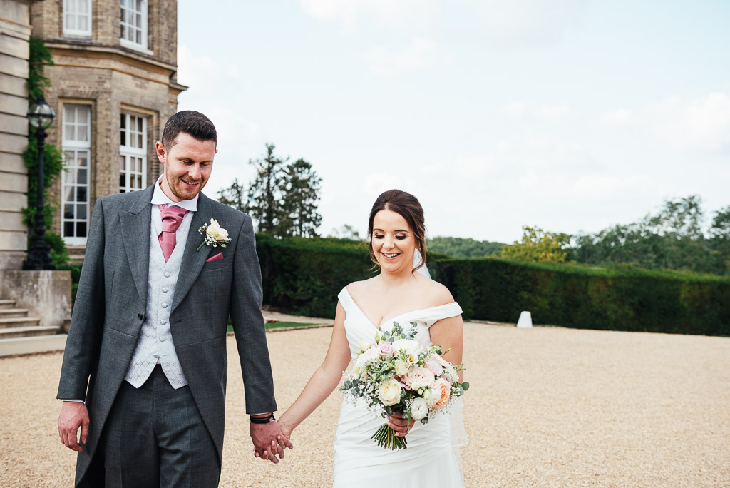 Relaxed couples portrait walking together in the grounds of Hedsor House