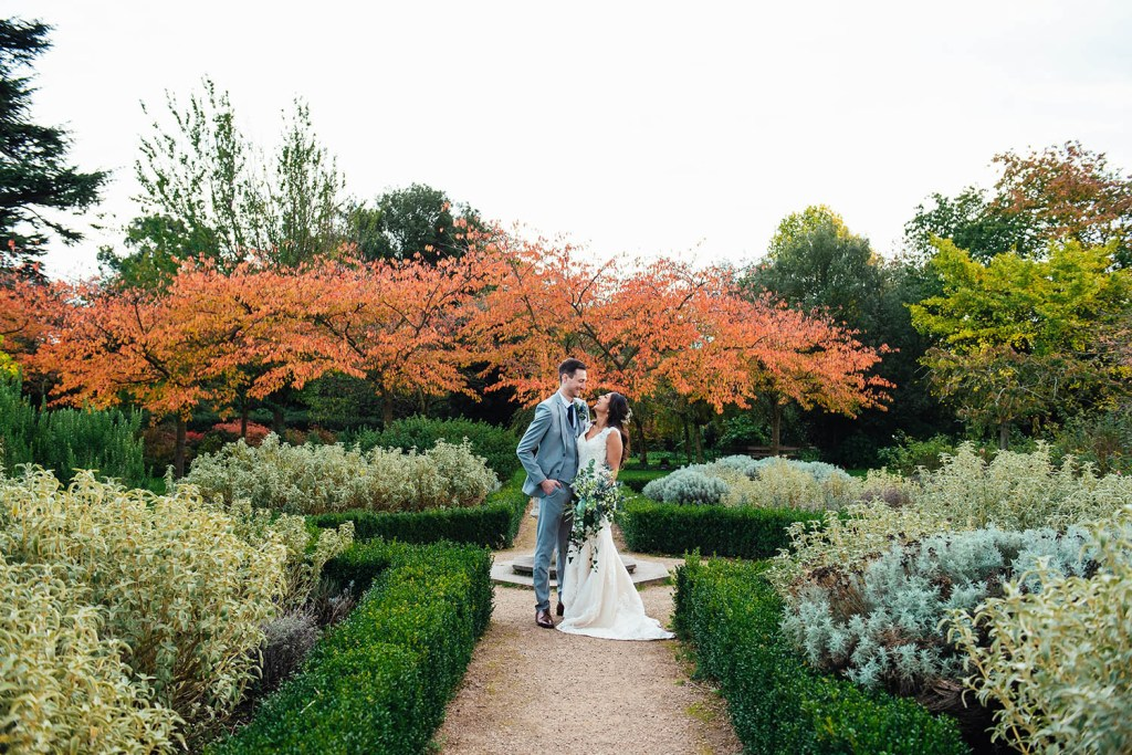 Creative couples portrait at Forty Hall with autumnal leaves