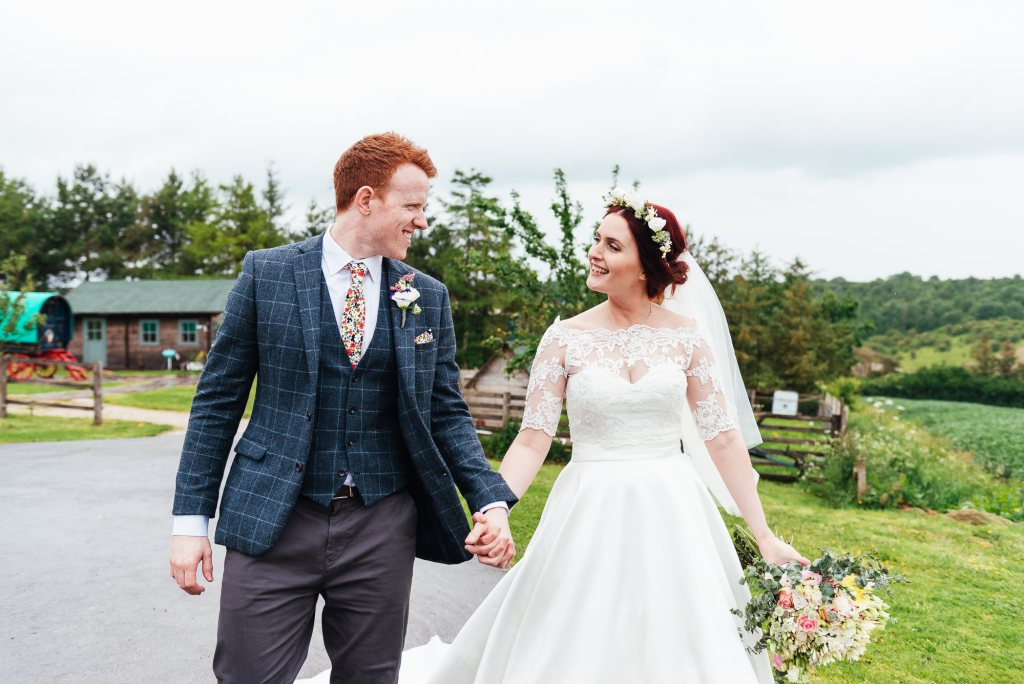 Natural wedding portrait as couple walks together at Deepdale Farm