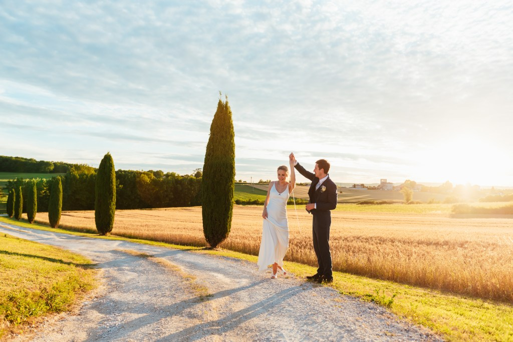 Couple dance in the French countryside at sunset
