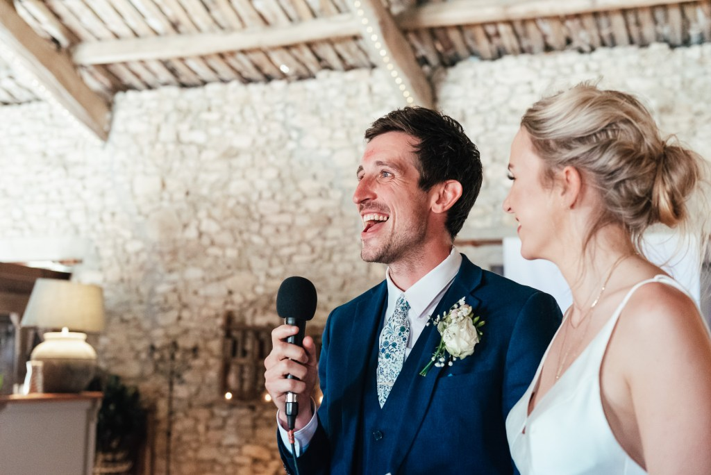 Bride and groom give a relaxed and emotive joint speech