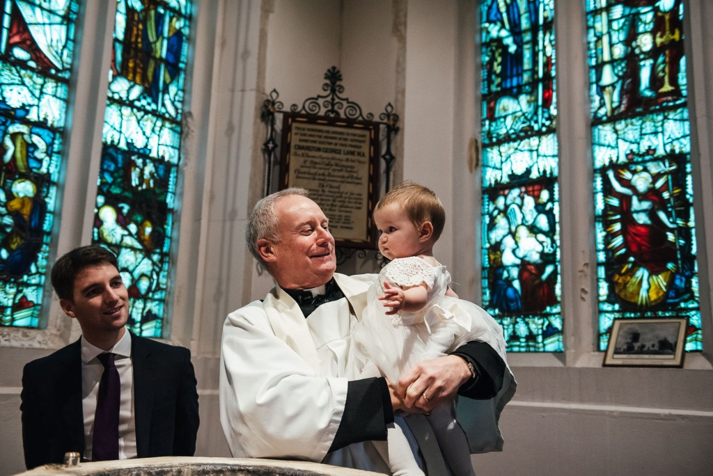 Baby is christened in Hertfordshire church