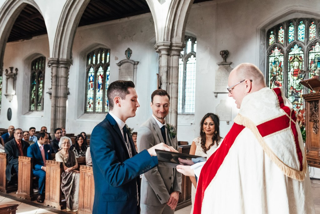Best man brings the wedding rings to the vicar