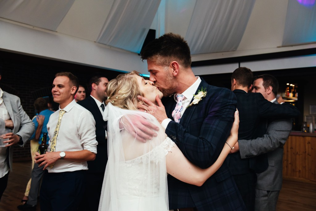 Bride and groom share a romantic first dance together
