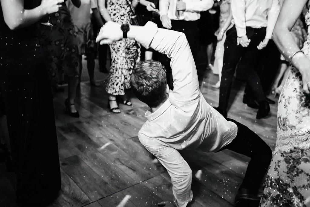 Fun dance floor photography, Busbridge Lakes Wedding