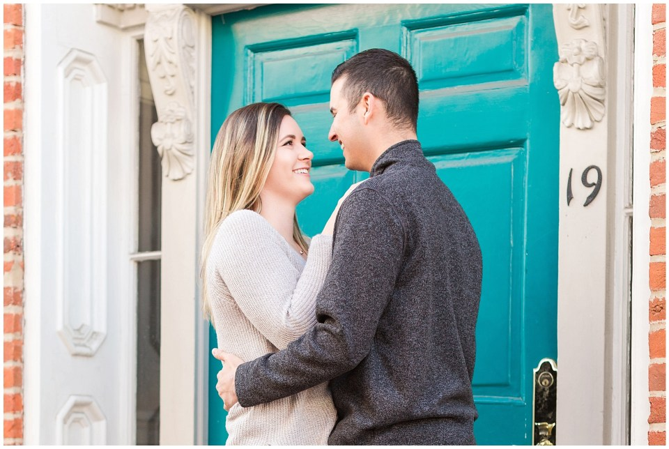 Teal blue door at an engagement session in downtown leesburg