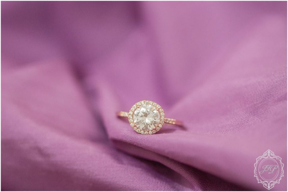 Image of rose gold ring on a purple silk throw in Columbia, South Carolina.