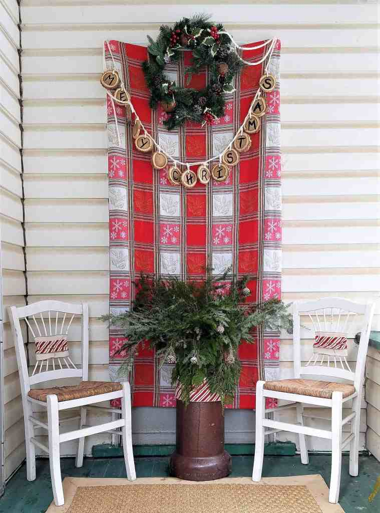 Christmas porch decor- chairs and terracotta planter