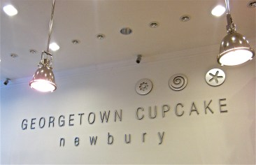 The Georgetown Cupcake logo displayed behind the counter.